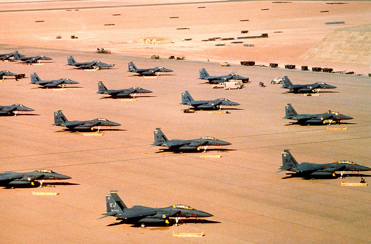 Flying and fighting series from around the world f 15e eagle fighter aircraft of the 4th tactical fighter wing seymour johnson air force base nc are parked on an air field during operation desert fandeluxe Image collections